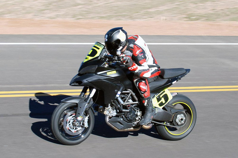 """1/3 - July 2011: Ducati rider sets motorcycle record at Pikes Peak with stock Multistrada 1200 Read the article here:   http://ca.autoblog.com/2011/07/03/ducati-rider-sets-motorcycle-record-at-pikes-peak-with-stock-mul/ Photos copyright Jensen Beeler   <p>See: <b><a target=""""_blank"""" href=""""http://www.motorcycleinfo.co.uk/index.cfm?fa=contentGeneric.wuyjdrgpolhdvlck"""">Multistrada 1200 Info & Resources</a></b></p>"""
