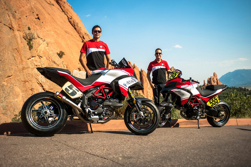"""2/8: August 2012 - Ducati Multistrada 1200 wins Pikes Peak again! The Ducati Multistrada 1200 S Pikes Peak wins for 3rd time. Both Carlin Dunne and Spider Grips Ducati team mate and six-time winner Greg Tracy finished the race under the 10-minute barrier, which is a first for any motorcycle in the race's 90-year history. Dunne crossed the finish line at the 14,110-foot summit of Pikes Peak with the record-setting time of 9:52.819, beating his previous record of 11:11.32, while Tracy was less than six seconds behind, placing second with 9:58.262. See:  <b><a target=""""_blank"""" href=""""http://www.motorcycleinfo.co.uk/index.cfm?fa=contentGeneric.wuyjdrgpolhdvlck"""">Multistrada 1200 Info & Resources</a></b>"""