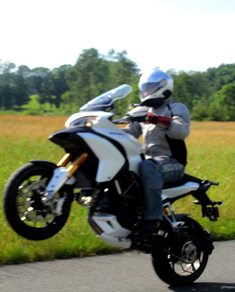 """1/2: Multistrada 1200 wheelie by ducati.ms forum member 'Epee' (aka Doug T)    <p>See: <b><a target=""""_blank"""" href=""""http://www.motorcycleinfo.co.uk/index.cfm?fa=contentGeneric.wuyjdrgpolhdvlck"""">Multistrada 1200 Info & Resources</a></b></p>"""