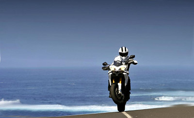 Multistrada 1200 wheelie - cool shot :-)   See: Multistrada 1200 Info & Resources