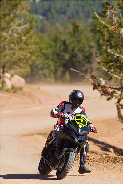 "2/3 - July 2011: Ducati rider sets motorcycle record at Pikes Peak with stock Multistrada 1200 Read the article here:   http://ca.autoblog.com/2011/07/03/ducati-rider-sets-motorcycle-record-at-pikes-peak-with-stock-mul/ Photos copyright Jensen Beeler   <p>See: <b><a target=""_blank"" href=""http://www.motorcycleinfo.co.uk/index.cfm?fa=contentGeneric.wuyjdrgpolhdvlck"">Multistrada 1200 Info & Resources</a></b></p>"