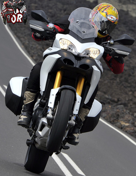 """Multistrada 1200 wheelie - front wheel well in the air :-) Image from www.raptorsandrockets.com   <p>See: <b><a target=""""_blank"""" href=""""http://www.motorcycleinfo.co.uk/index.cfm?fa=contentGeneric.wuyjdrgpolhdvlck"""">Multistrada 1200 Info & Resources</a></b></p>"""