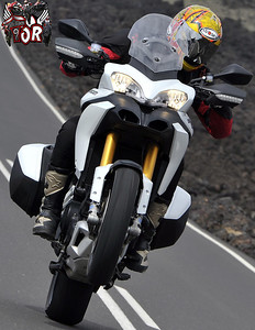 Multistrada 1200 wheelie - front wheel well in the air :-) Image from www.raptorsandrockets.com   See: Multistrada 1200 Info & Resources