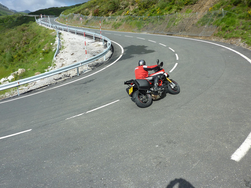 "Ok not a track or stunt shot but a great 'action' shot on the road. Ducati.ms member 'Upturn666' enjoying some twisties on his new Multistrada 1200 Pikes Peak Special Edition (PPSE)   <p>See: <b><a target=""_blank"" href=""http://www.motorcycleinfo.co.uk/index.cfm?fa=contentGeneric.wuyjdrgpolhdvlck"">Multistrada 1200 Info & Resources</a></b></p>"