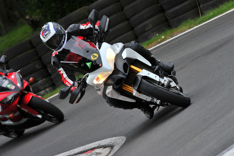 5/6 Ducatisti.co.uk member andywilson and his multistrada 1200 at cadwell race circuit May 2011 <i>An event run by Lincolnshire police road safety partnership £75 for the full day , got split into groups of  4 riders with one instructor , did emergency braking (managed to lock the back end up with ABS turned off) , slow speed manouvering , cornering skills and road positioning  Then following the instructor around to learn the circuit and in the afternoon you got to go around on your own , fantastic day I have signed up to do it again in September </i>