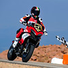"1/8: August 2012 - Ducati Multistrada 1200 wins Pikes Peak again! The Ducati Multistrada 1200 S Pikes Peak wins for 3rd time. Both Carlin Dunne and Spider Grips Ducati team mate and six-time winner Greg Tracy finished the race under the 10-minute barrier, which is a first for any motorcycle in the race's 90-year history. Dunne crossed the finish line at the 14,110-foot summit of Pikes Peak with the record-setting time of 9:52.819, beating his previous record of 11:11.32, while Tracy was less than six seconds behind, placing second with 9:58.262. See:  <b><a target=""_blank"" href=""http://www.motorcycleinfo.co.uk/index.cfm?fa=contentGeneric.wuyjdrgpolhdvlck"">Multistrada 1200 Info & Resources</a></b>"