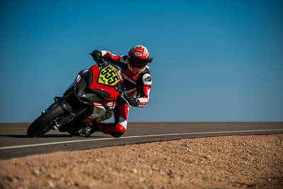 9/9: 2012 -The Ducati Multistrada 1200 S Pikes Peak wins for the 3rd year in succession. Photos courtesy of Ducati Chile The winning riders was Greg Tracy. The track record for bikes of 10 minutes, standing for something like 90 years was broken by Carlin Dunne with a time of 9'52'829 while Tracy also broke the 10 min barrier with a best time of 9'58'262.