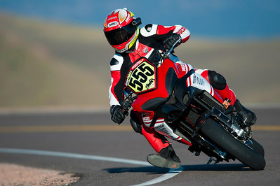 3/9: 2012 -The Ducati Multistrada 1200 S Pikes Peak wins for the 3rd year in succession. Photos courtesy of Ducati Chile The winning riders was Greg Tracy. The track record for bikes of 10 minutes, standing for something like 90 years was broken by Carlin Dunne with a time of 9'52'829 while Tracy also broke the 10 min barrier with a best time of 9'58'262.