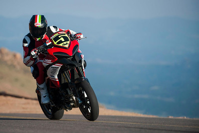 6/9: 2012 -The Ducati Multistrada 1200 S Pikes Peak wins for the 3rd year in succession. Photos courtesy of Ducati Chile The winning riders was Greg Tracy. The track record for bikes of 10 minutes, standing for something like 90 years was broken by Carlin Dunne with a time of 9'52'829 while Tracy also broke the 10 min barrier with a best time of 9'58'262.