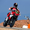 "2/9: 2012 -The Ducati Multistrada 1200 S Pikes Peak wins for the 3rd year in succession. Photos courtesy of <a target=""_blank"" href=""http://ducati-chile.cl/"">Ducati Chile</a> The winning riders was Greg Tracy. The track record for bikes of 10 minutes, standing for something like 90 years was broken by Carlin Dunne with a time of 9'52'829 while Tracy also broke the 10 min barrier with a best time of 9'58'262."