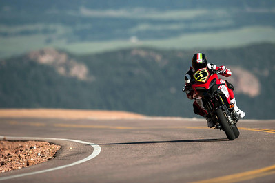 7/9: 2012 -The Ducati Multistrada 1200 S Pikes Peak wins for the 3rd year in succession. Photos courtesy of Ducati Chile The winning riders was Greg Tracy. The track record for bikes of 10 minutes, standing for something like 90 years was broken by Carlin Dunne with a time of 9'52'829 while Tracy also broke the 10 min barrier with a best time of 9'58'262.