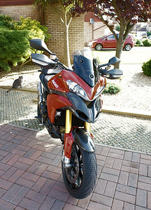 4/6: Multistrada 1200 PUIG Sport (short) Screen No back to back testing with a stock screen as I used mine to make my own DIY sport/shorty....but I recall only too well how keen I was to ditch the standard screen because of buffeting and turbulence....my DIY shorty is a major improvement, windy obviously (good helmet [Shoei Qwest] and ear plugs a benefit;-) but good clean air flow. The PUIG short screen was better still, REALLY smooth air flow off it, NO turbulence or buffeting. I guess the 'double bubble' type shape of the screen helps. ('Buffeting - obviously you'll get some buffeting regardless of screen in certain conditions such as gusting cross winds or passing through a big truck 'wake')  A big thumbs up from me :D ...but I guess I'm a bit vain lol..........my DIY screen is going back on purely as I like the look :D