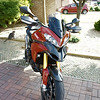 4/6: Multistrada 1200 PUIG Sport (short) Screen <i>No back to back testing with a stock screen as I used mine to make my own DIY sport/shorty....but I recall only too well how keen I was to ditch the standard screen because of buffeting and turbulence....my DIY shorty is a major improvement, windy obviously (good helmet [Shoei Qwest] and ear plugs a benefit;-) but good clean air flow. The PUIG short screen was better still, REALLY smooth air flow off it, NO turbulence or buffeting. I guess the 'double bubble' type shape of the screen helps. ('Buffeting - obviously you'll get some buffeting regardless of screen in certain conditions such as gusting cross winds or passing through a big truck 'wake')  A big thumbs up from me :D ...but I guess I'm a bit vain lol..........my DIY screen is going back on purely as I like the look :D</i>