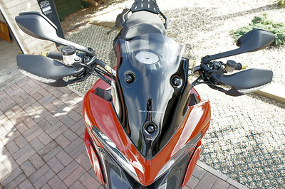 6/6: Multistrada 1200 PUIG Sport (short) Screen No back to back testing with a stock screen as I used mine to make my own DIY sport/shorty....but I recall only too well how keen I was to ditch the standard screen because of buffeting and turbulence....my DIY shorty is a major improvement, windy obviously (good helmet [Shoei Qwest] and ear plugs a benefit;-) but good clean air flow. The PUIG short screen was better still, REALLY smooth air flow off it, NO turbulence or buffeting. I guess the 'double bubble' type shape of the screen helps. ('Buffeting - obviously you'll get some buffeting regardless of screen in certain conditions such as gusting cross winds or passing through a big truck 'wake')  A big thumbs up from me :D ...but I guess I'm a bit vain lol..........my DIY screen is going back on purely as I like the look :D