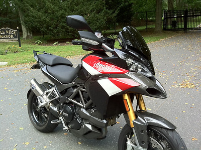 When is a Pikes Peak Multistrada not a PP Multistrada 1200?.......have another look ;-) 1/3 - Ducati.ms member 'fixinbones' (aka Jay) sweet black Multistrada 1200.....a year on and black no longer! This is not a PP bike. My bike was purchased in 2010. I loved the PP look so I just added some of the PP body panels to a regular MS1200S sport model. Also a bunch of CF bits on top of what the bike already came with.