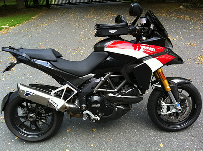 When is a Pikes Peak Multistrada not a PP Multistrada 1200?.......have another look ;-) 2/3 - Ducati.ms member 'fixinbones' (aka Jay) sweet black Multistrada 1200.....a year on and black no longer! This is not a PP bike. My bike was purchased in 2010. I loved the PP look so I just added some of the PP body panels to a regular MS1200S sport model. Also a bunch of CF bits on top of what the bike already came with.