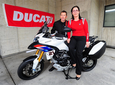 "First Look: Ducati Multistrada 1200 Troy Bayliss One of the best bikes of 2010 gets the Aussie touch: Posted: 7 May 2010  by Visordown News  http://www.visordown.com ""WE'RE NOT sure what the Nana Mouskouri look-a-like's doing in the shot, but the bloke behind her is multiple WSB champ Troy Bayliss, pictured with the Ducati 1200 Multistrada Troy Bayliss special. Details are scant, so we can't tell you just yet whether we should expect the Bayliss tribute in dear Old Blighty. Ducati UK know nothing about it and, following a phone call from Visordown, are looking into the situation. We'll keep you posted.  We reckon the subtle use of the Australian flag makes the Multi look pretty tasty.  Now there are two words you don't expect to see in the same sentence."