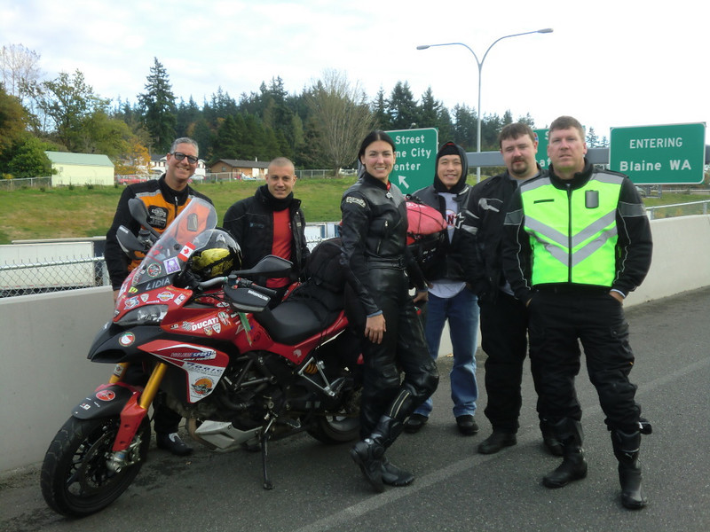 """Ducati Seattle's Photos - Giro Del Mondo in 80 DOC! Paolo Pirozzi visits Ducati Seattle """"<i>Cheese!</i>"""" More photos here: http://www.facebook.com/DucatiSeattleFan  Article here:  http://www.motorcycleinfo.co.uk/index.cfm?fa=contentGeneric.svujwmxokbhbwyoc&pageId=2314121"""