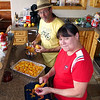 Scott M. & Pam making the magic peach cobbler.