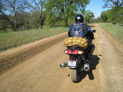 Steve Tourdo rolls his mighty ZZR1200 over a freshly grated road not know as 'part of the approved route'.