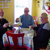 """Three tough dudes in a typical BMW rider """"Biker Bar"""".  Notice Ken's extended pinky as he holds his tea!"""