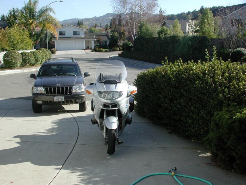Dirty bike with dirty jeep
