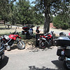 Jean and her 696, my Super Tenere is in the shade.  Mt. Nebo rest stop.  Don's K1600GTL in front right.