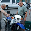 Don and Andy trying to figure out why Andy's bike doesn't want to start.