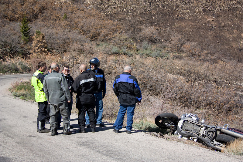 Dudes standing around admiring Troy's downed wing-a-ding-ding. No one was injured and Troy's wing was uprighted and rolled down the road soon after.