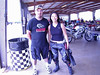 """Nutmegchoi,"" as she's known on <a href=""http://www.twtex.com"">twtex.com</a> and other boards, and her boyfriend, I think.  Nice person, nice smile. <a href=""http://www.bitsof.info/moto/trackdays/TY_RSTD29May06.wmv"">Decent rider</a>, too, as far as I can tell. :)"