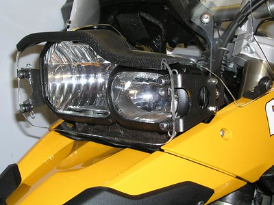 F800GS LightGuard.  The side brackets are crafted from stainless steel.  The plexiglass shield can be removed for cleaning in seconds, by pulling 4 quick-release hairpin cotter pins.    The rubber light seal across the top prevents light from reflecting back into the rider's eyes when riding at night.