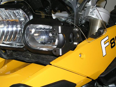 Left bracket in place.  You can still make adjustments to the aiming point of your headlight.