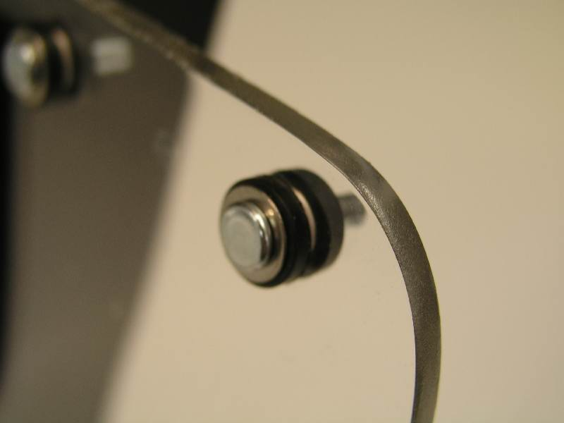 Closeup of the pin, the washer, 2 grommets, and the plexi shield