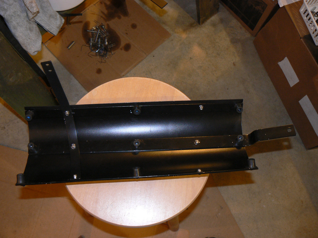 My own built heat shield and tool tube mounting:<br /> Back side of heat shield. Flat alum for strength and support, rubber stoppers to rest against muffler-test these already and no meltage (or at least very little)