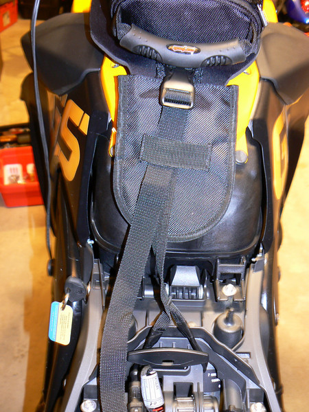 Installing Tourmaster Super Mini Tank Bag:<br /> have to move the strap to the left to allow the seat latch to operate