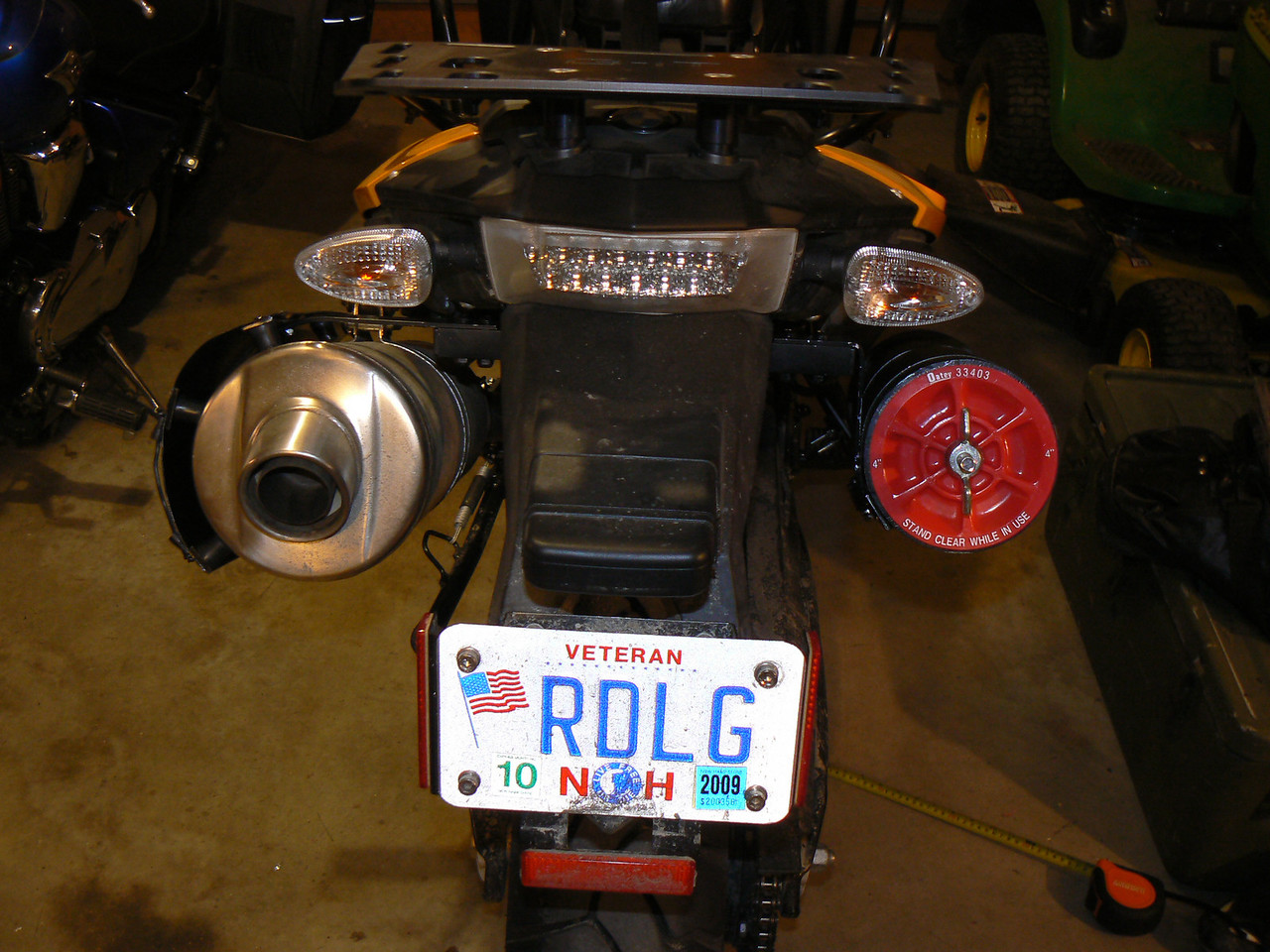 My own built heat shield and tool tube mounting:<br /> rear view of it all mounted up