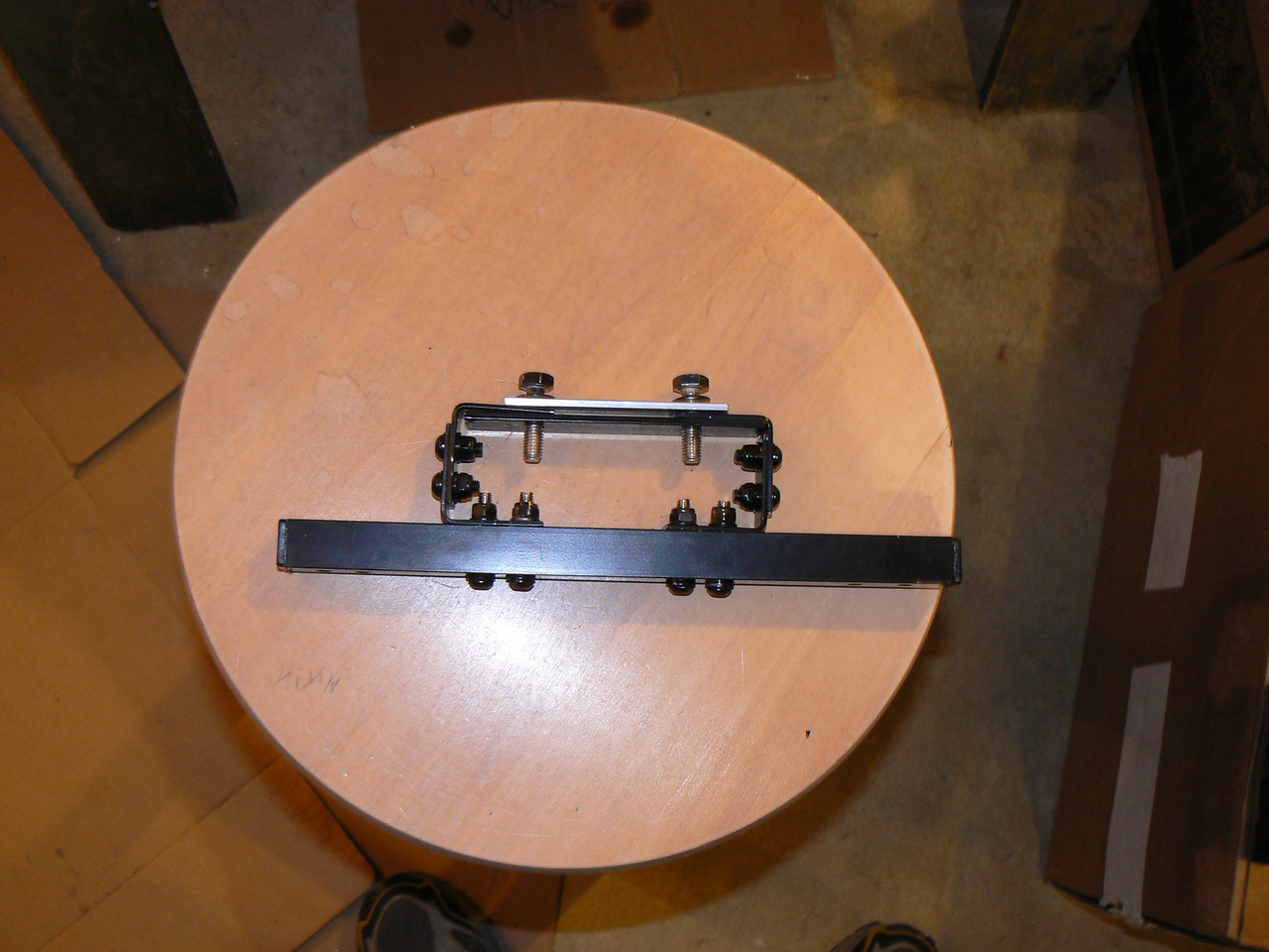 "My own built heat shield and tool tube mounting: (Because I can't weld and can be cheap sometimes)<br /> This is the main support bracket. Built with 1"" square aluminum tube, 4 galvanized ""L"" brackets, and some flat alum stock. This will support the heat shield and tool tube supports towards the rear of the bike."