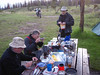 June 09 roughing it over dinner, rainbow trout, moose stew, wild rice, salads, 2 kinds of wine. 90 km from nearest village