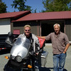 Whitney on his new to him R1150GS. Previous owner on the right.