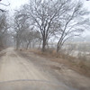 gravel ranch road paralleling river