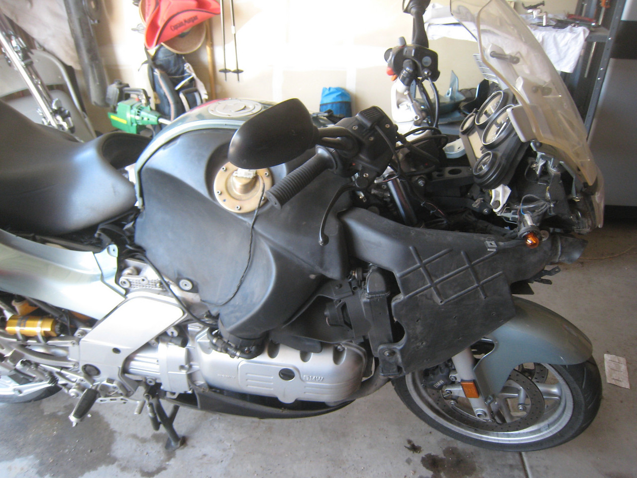 First things, first.  I strip the plastic off the bike and remove the Gadget-Guy GPS mount.
