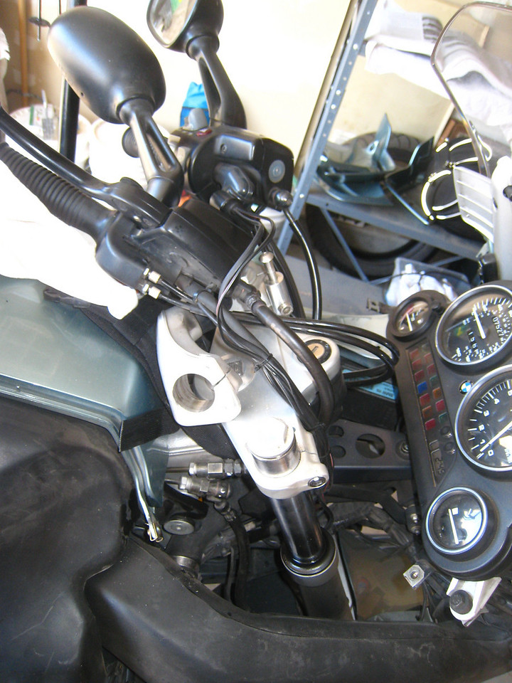 After removing these three bolts, the handlebar assembly can be removed.