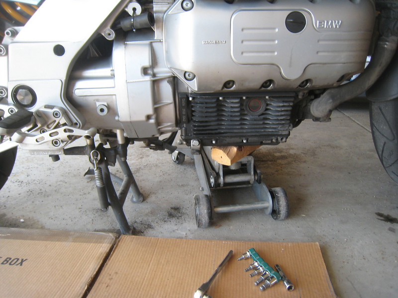Next, I support the motorcycle with a floor jack to get the load off the forks.