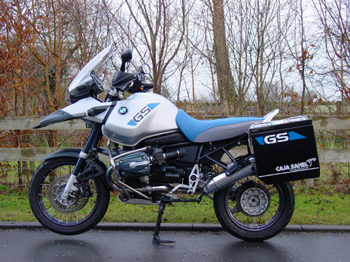 Nick Marshall's bike fitted with Caja Sahel pannier bags,Nick fitted my Blue& White reflective tank stickers to the panniers.