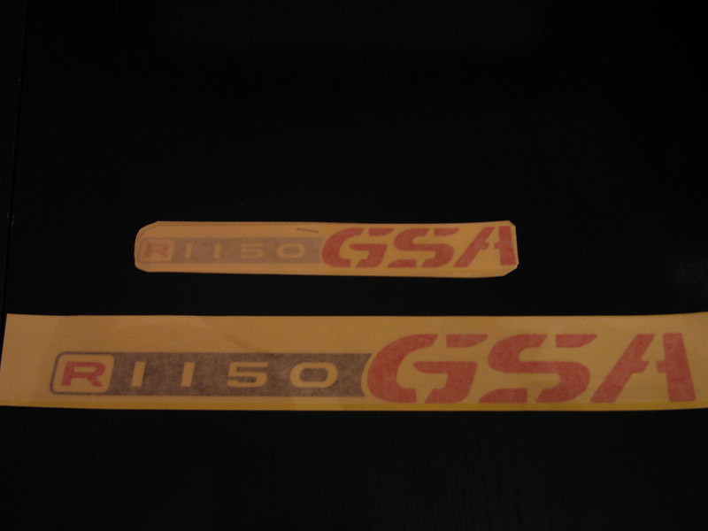 R1150GSA stickers, a variation of the 12oo type.Shown here in Black & Red reflective vinyl,this shot was taken with protective tape in place,the Large sticker is suitable for panniers,the small version is suitable for the beak of the bike,a crash helmet or top box etc..