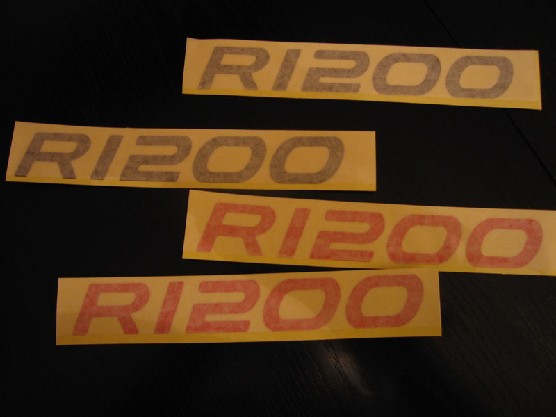 Direct replacement tank stickers for the R1200GS Adventure in Red reflective & Black reflective vinyl.