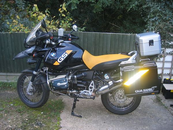 A customers bike with my stickers in reflective vinyl fitted to the panniers.<br /> Pic taken with  FLASH!