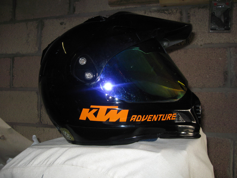 Adventure word and KTM logo in Orange standard vinyl,might appeal to KTM owners?<br /> To be available through humvee-graphics.com in 2 sizes,shown is the larger 125mm version of the Adventure word together with the smaller of 2 versions of the KTM logo at 95mm.