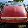 The Isetta is an Italian-designed microcar <br /> <br /> <br /> The Isetta caused a sensation when it was introduced to the motoring press in Turin in November 1953,. Small  (7.5 ft) long by (4.5 ft) wide) and egg-shaped, with bubble-type windows, the entire front end of the car hinged outwards to allow entry. In the event of a crash, the driver and passenger were to exit through the canvas sunroof. The steering wheel and instrument panel swung out with the single door, as this made access to the single bench seat simpler. The seat provided reasonable comfort for two occupants, and perhaps a small child. Behind the seat was a large parcel shelf with a spare wheel located below. A heater was optional, and ventilation was provided by opening the fabric sunroof.<br /> <br /> BMW made the Isetta its own. They redesigned the powerplant around a BMW one-cylinder, four-stroke, 247 cc motorcycle engine which generated 10 kW (13 hp). Although the major elements of the Italian design remained intact, BMW re-engineered much of the car, so much so that none of the parts between a BMW Isetta Moto Coupe and an Iso Isetta are interchangeable. The first BMW Isetta appeared in April 1955.<br /> <br /> The BMW Isetta was the top-selling single-cylinder car in the world, with 161,728 units sold.<br /> <br /> In May 1962, three years after launching the conventionally modern-looking BMW 700, BMW ceased production of Isettas<br /> <br /> From Wikipedia, the free encyclopedia 2013 Wisconsin BMW Motorcycle Rally
