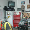 Nice speakers. Work benches with peg board, drawer, storage under, helmet shelf